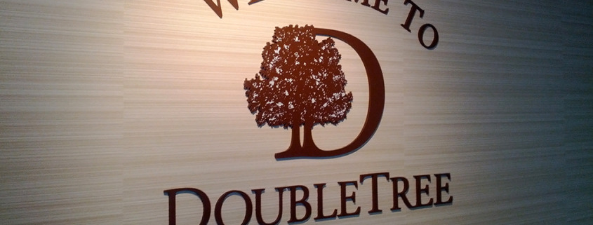 DoubleTree by Hilton hotel sign, dimensional laser cut acrylic, mounted to interior wall, Signs for Success for fast service in Spokane, call now