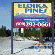 Eloika Pines reflective highway sign in daylight