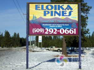 Eloika Pines reflective highway sign in daylight, custom reflective signs