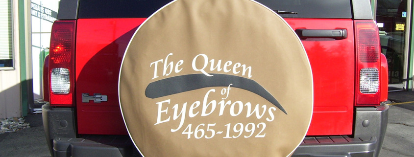 Signs for Success can print white ink in Spokane, on colored marine grade vinyl fabric, that was sewn into a custom tire cover for Queen of Eyebrows
