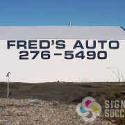 You can see this Fred's Auto wall sign from the highway hundreds of feet away, high performance cut black vinyl on the corrugated side of this automotive building