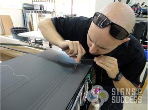 Vehicle Wrap installation using knifeless tape
