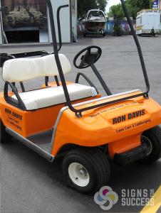 Orange golf cart wraps with black lettering