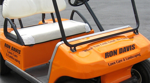 Orange golf cart wrap with black lettering
