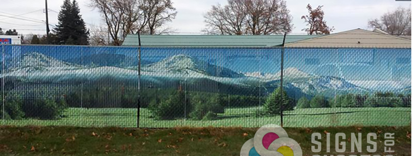 Example of how Custom Chain Link Fence Slats for privacy fencing shows through by Signs for Success, custom signs