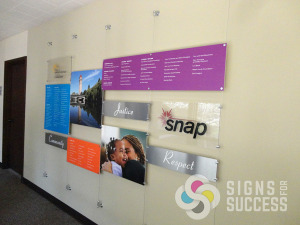Dimensional look with cables and standoffs for Snap Spokane, designed, printed, installed by Signs for Success, call now for great, fast service, stand off signs