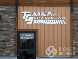 Dimensional aluminum letters and metal laminate letters can be a great addition for adding your logo to your building like Talisman Construction in Spokane