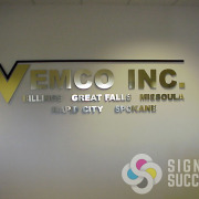 Vemco wanted metal letters without the high cost, so real metal laminate on acrylic gave them the look for this interior lobby sign that fit their budget in Spokane