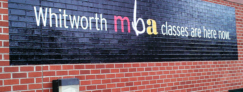Historic building signs benefit from conformable wall vinyl that comes off clean and advertising can be added without damage to walls, Whitworth U-District Spokane, vinyl wall wraps