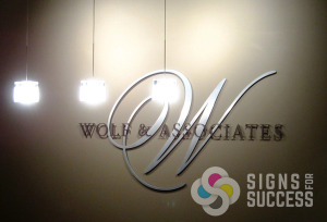 Lobby signs of dimensional letters look great on the wall like this one for Wolf & Associates in Spokane, of cut metal and acrylic