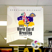 Shaped pennant banner for 2002 world cup wrestling in Spokane, WA call now for fast quote from Signs for Success, vinyl banners spokane