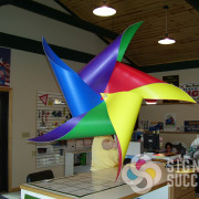 Signs for Success designed, printed, and manufactured this large custom pinwheel for a stage prop for KSPS television in Spokane, Give us a call now for fast sign service in Spokane
