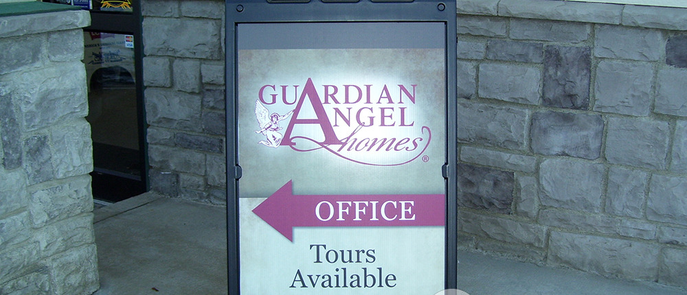 Wayfinding with a sidewalk sign a-frame with changeable faces, this style comes in black or white, made for Guardian Angel Homes, a-frame signs spokane