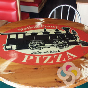 Table Top custom printed, then clear coated for a logo or message on your restaurant table, like this one for Station House Pizza in Hillyard, Give us a call now for fast sign service in Spokane
