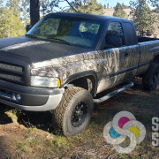 John's matte black and camouflage wrap on Dodge pickup truck by Signs for Success in Spokane