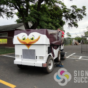 STCU advertising sponsor for Zamboni wrap, update an old piece of equipment with a custom, unique wrap by Signs for Success