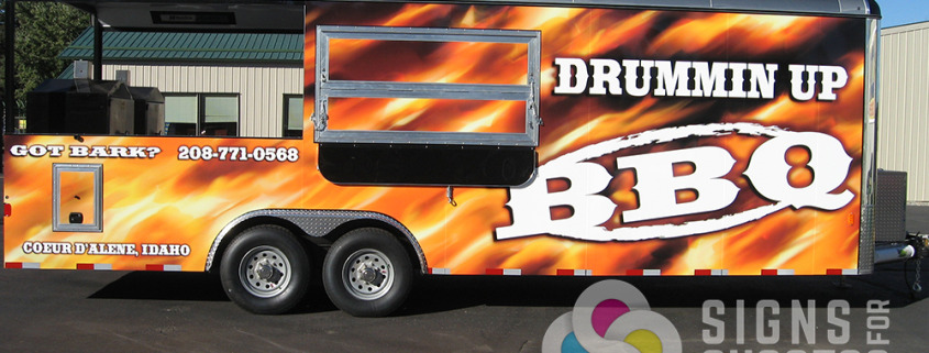 Drummin Up BBQ gets more business with this custom concession trailer wrap designed & installed by Signs for Success in Spokane, Call now for fast signs service, vehicle graphics spokane