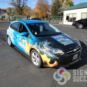 Full wrap for fleet graphics for JRCC in Moses Lake, call Signs for Success for your fleet graphics needs, quick, fast, instant quotes and signs in Spokane, car wrap installation spokane