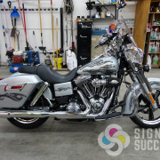 Custom designed flames tribal art on motorcycle, printed on clear vinyl using colors and white inks, installed by certified installers on motorcycle, motorcycle wrap, off-road vehicle wraps