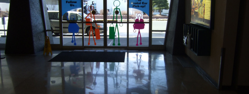 When Spokane Airport updated their rental car lots, they needed fun signage for wayfinding, and used these floor decals of cut out footprints withstick figures walking on doors