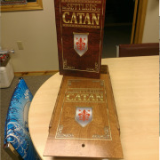 These custom Catan game boxes for wedding party groomsmen gifts were printed on the sliding wood lid, and on laser cut wood game pieces, and on marine grade vinyl for a custom mat board