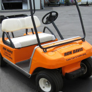 Golf cart wrap, changing color from white to bright orange, adding logo and text over colorchange, Wrap your golfcart now by Signs for Success, fast sign service in Spokane