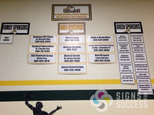 custom sponsor school signs hanging in gym