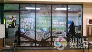 HR Block window graphics supplied, Signs for Success installed at Fairchild AFB near Airway Heights and Medical Lake