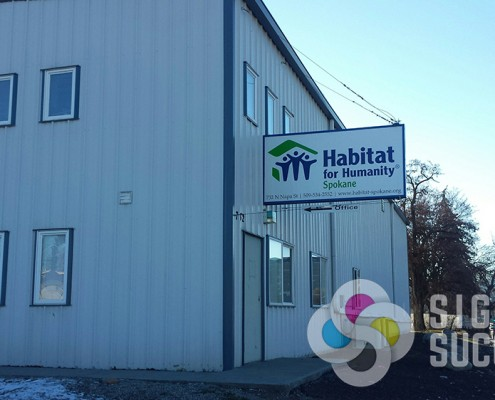 Projecting and hanging signs are great for flag-mount type signs like this one for Habitat for Humanity Spokane