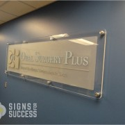 Clear acrylic sign with dimensional letters and polished Stand Offs, lobby signs Spokane