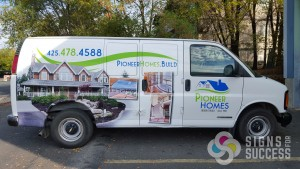 Pioneer Homes van wrap design featuring new logo, created by Signs for Success, get custom logo design Spokane
