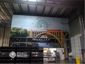 Custom printed vinyl wall wrap features Spokane Falls and Starbucks, large wall mural