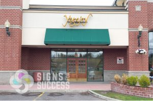 channel letters storefront sign is part of retail sign package for yogajoy