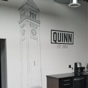 Vinyl Graphics on interior painted wall. Environmental Graphics logo wall graphics
