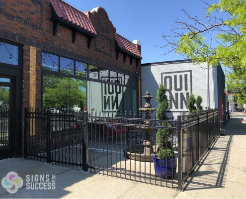 logo environmental graphics on outdoor brick wall, vinyl graphics spokane