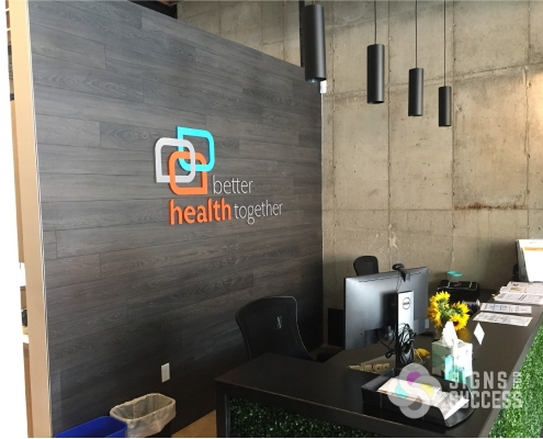 indoor office sign, dimensional logo sign made with flat cut out acrylic logo